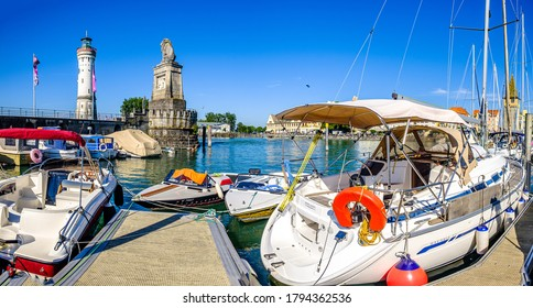 Lindau, Germany - August 6: famous harbor with sailboats at the historic island of Lindau am Bodensee on August 6, 2020
