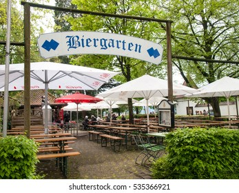 Lindau, Germany - May 2, 2015: Town Lindau- Streets of Old Town. Entry of a typical German beer garden in the town of Lindau.