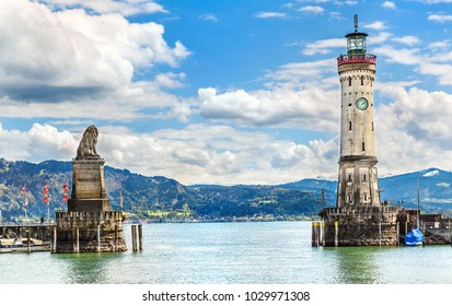 Lindau, Germany - May 5, 2017: Lighthouse and a lion statue at the entrance to the port of Lindau, Germany.