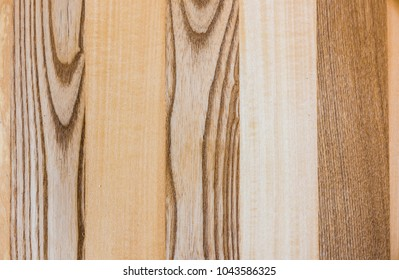 Linden and Ash wood texture A fragment of a wooden panel hardwood