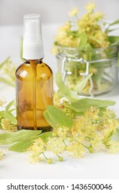 linden blossom and spa linden cosmetic in a bottle on a light background