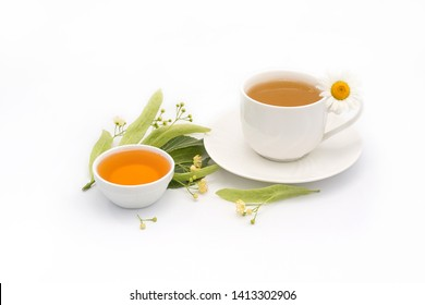 Linden inflorescences and linden honey, cup of camomile tea decorates flower - healthy lifestyle. View from high angle, space for a text. On a white background.