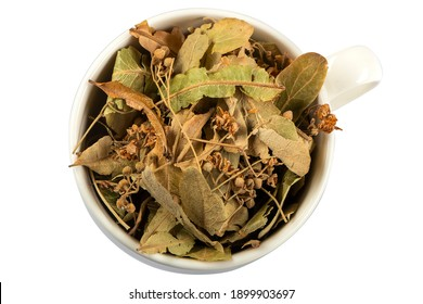 Linden leaves and flowers as a herbal tea in a cup over white background. Natural herbs medicine.