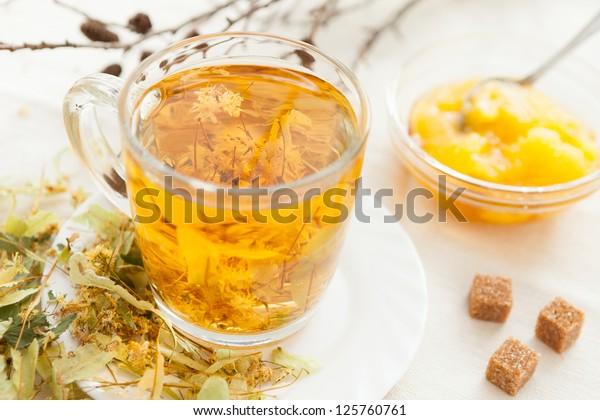 Linden tea with floral honey, closeup