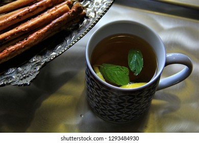 linden tea hot drink healty salty cookie salty biscuit silver plates lemon