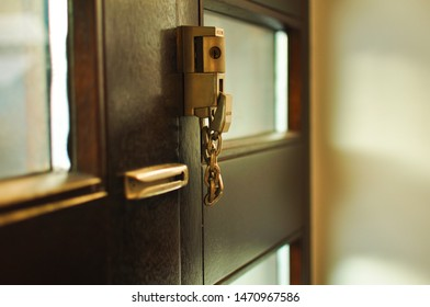 Lindenhof, Mannheim,Germany - august 4, 2019 : double lock with metal chain in the front door for extra security