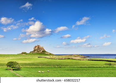 Lindisfarne Castle on Holy Island, off the Northumberland coast in the north east of England. The island is reached by a causeway which is covered by the sea at high tide.