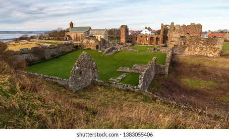 Lindisfarne Priory in Northumberland is an ancient ruin monastery dating back to 634 which was inhabited by Irish monks. Also, know as Holy Island.