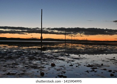 Lindisfarne UK Oct 28 2018 poles marking the Pilgrims way, a footpath over the tidal sands linking the Holy Island of Lindisfarne to the Northumberland Mainland
