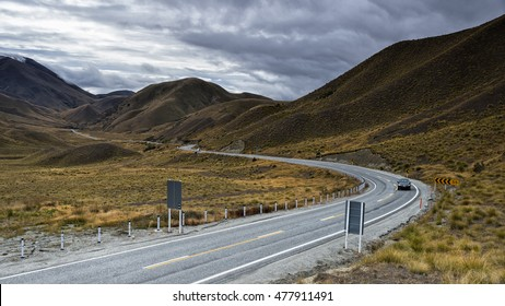 Lindiss pass, the road to Queenstown city in summer season with cloudy sky