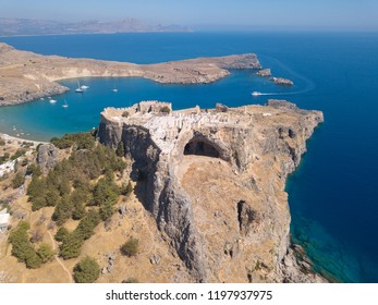 Lindos Acropolis - Aerial image of the Acropolis and blue bay of Lindos, Rodos (Greece).