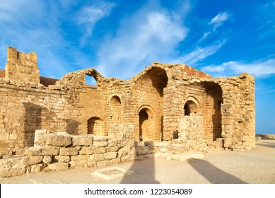 Lindos Acropolis fortified citadel during summer touristic season, archeology ruins, blue sky