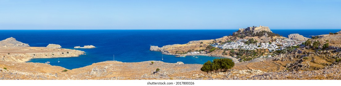 Lindos, with its ancient acropolis, ruins fortress and closed bays in sea coast, is the most view place of Rhodes island in Dodecanese, Greece. Vacation on Greece islands in Mediterranean sea.