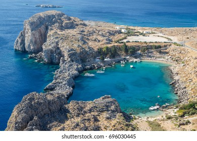 LINDOS / GREECE - AUGUST 2014: People bathing in St.Paul's Bay in Lindos, Rhodes island, Greece