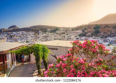 LINDOS, GREECE - MAY 2018: Beautiful architectural traditional buildings and decorated houses in Lindos village. Scenic view of Greek house in Lindos village, Rhodes island, Dodecanese, Greece, Europe