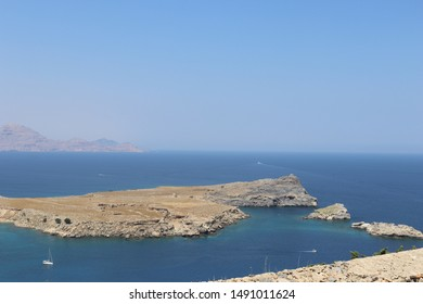 Lindos, Island of Rhodes/Greece - circa august 2019: A slightly blurred landscape of blue sea and sky at the entrance in St. Paul's bay in Lindos