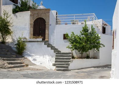 Lindos, Rhodes / GREECE - 7 September, 2018: Lindos village streets without tourists, beautiful white houses and narrow streets during summer season, amazing place