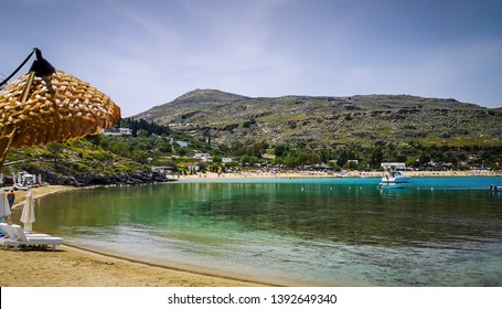 Lindos ,Rhodes / Greece : Cloudy day at the historic village .LIndos bay, the sea is calm and the beach is still empty until summer comes,the eagean ocean so clean and colorful