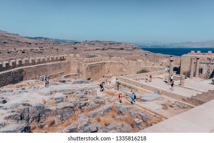 LINDOS, RHODES, GREECE - SEPTEMBER 07 2018: Ruins of Acropolis in Lindos, Rhodes, Greece