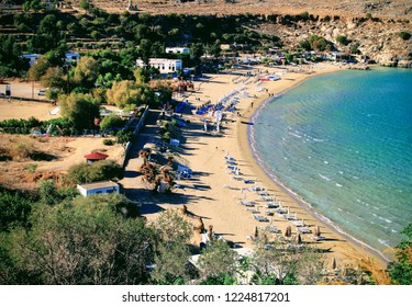 Lindos, Rhodes, Greece,25/10/2018.A view of the beach and sun bathing area beside the town of Lindos,