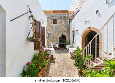 LINDOS/GREECE - August 23, 2017: Courtyard of Kalypso greek restaurant in Lindos town at Rhodes island