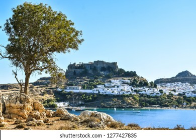 LINDOS,RHODES/GREECE OCTOBER 29 2018 : Lindos village and Lindos bay,photo taken from Kleovoulos Tomb hill.