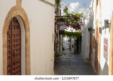 lindos,Rhodes,greece,13/10/2018.One of the many narrow streets of Lindos, a small fishing village very popular with tourists. The houses are mainly whitewashed.