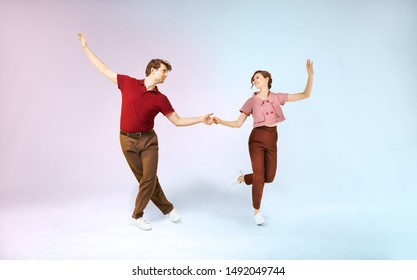 Lindy hop couple in motion in retro vintage style is dancing to the jazz