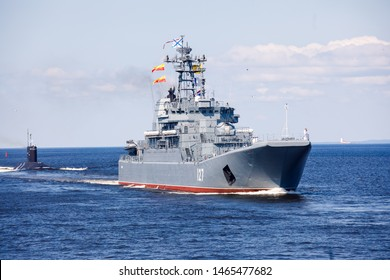 A line ahead of modern russian military naval battleships warships in the row, northern fleet and baltic sea fleet, summer sunny day