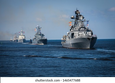 A line ahead of modern russian military naval battleships warships in the row, northern fleet and baltic sea fleet, summer sunny day