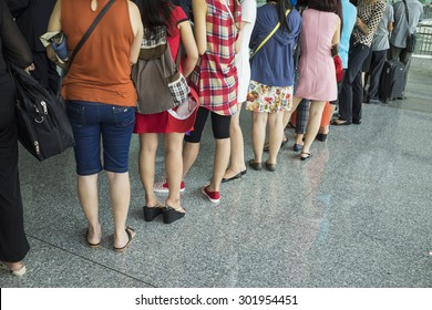 Line of airline Asian passenger waiting at boarding gate