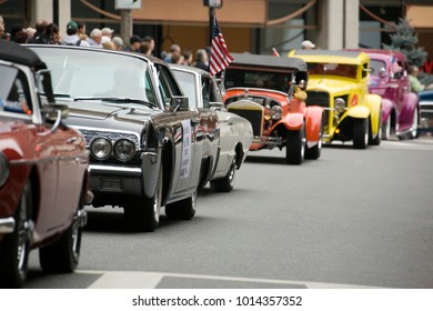 Line of American cars driving past.