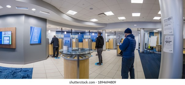 Line in a bank, people wearing the mask and waiting in the line, Bronx, New York, United States, 1.15.2021
