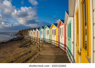 Line of beach huts above the beach