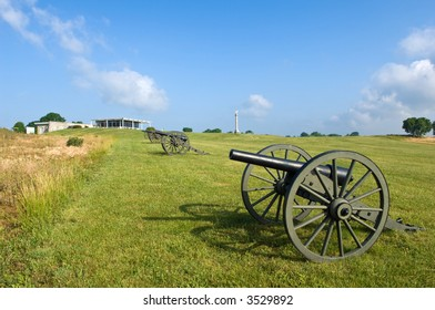 A line of cannon at the Antietam Battlefield in Sharpsburg, Maryland, USA leads to the visitor's center.