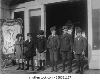 Line of children found in a penny arcade at 1:30 P.M. As many of the schools in Schenectady run on 'half time' they are not necessarily truants.' NY, photograph by Lewis Wickes Hine, February, 1910