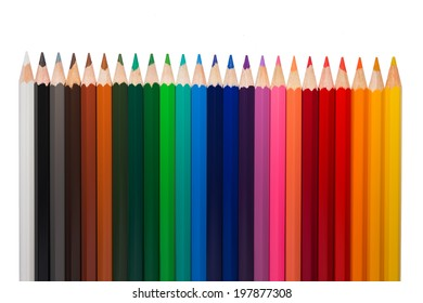 Line of colored pencils isolated on white