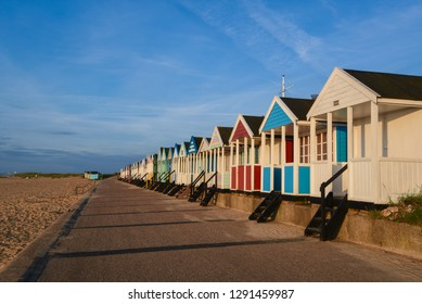 Line of colourful beach huts on the promenade at Southwold, Suffolk. UK