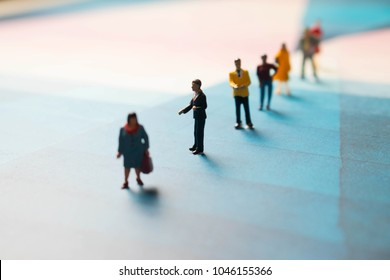 Line of diverse men and woman standing in a line. Ordinary people standing in a row. Unrecognizable miniature people.