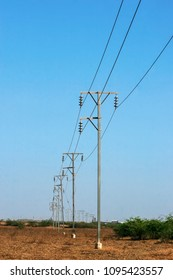 The line of electric poles with cables of electric, Gujarat, india.
