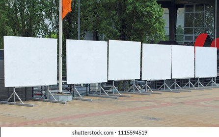 Line of empty outdoor displays on commercial promotional event