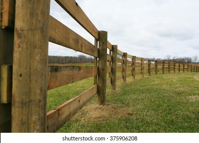 A line of fencing along a pasture