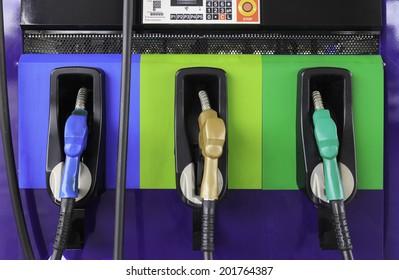 line of gasoline pump nozzles