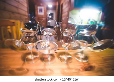 A line of glasses during process of making and drinking hot flaming sambuca cocktail with fire at home