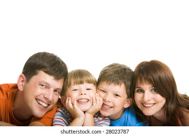 Line of happy family members having fun and looking at camera