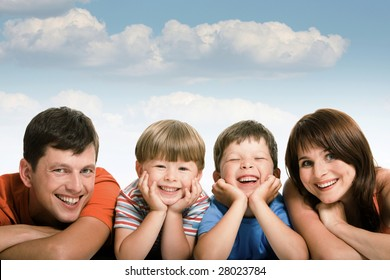 Line of happy family members looking at camera and smiling over white background