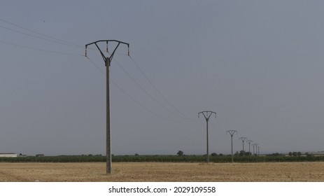 Line of medium-voltage electricity pylons in the middle of the Spanish countryside, Spain Europe.