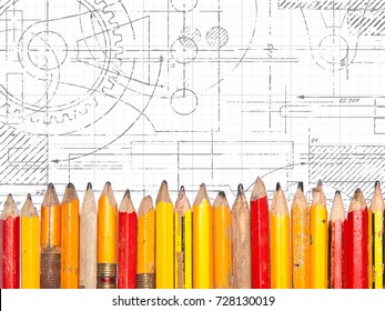 Line of old pencils on technical drawing background