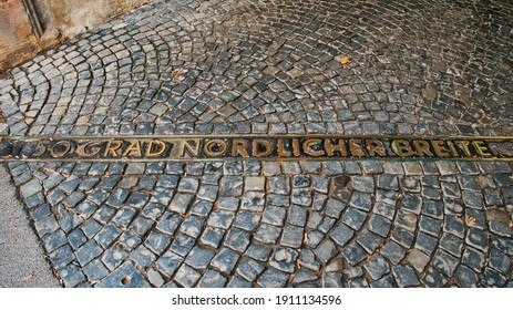A line on the cobblestones of Rüsselsheim Castle marks the place where the 50th parallel north runs Translation: 50th degree northern latitude
