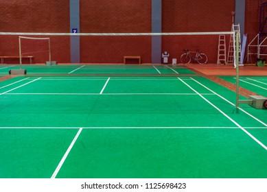 line on green badminton court.